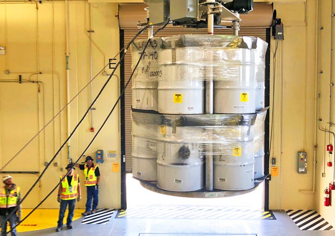 In this April 2019, file photo, provided by Los Alamos National Laboratory, barrels of radioactive waste are loaded for transport to the Waste Isolation Pilot Plant (WIPP) at the Radioactive Assay Nondestructive Testing (RANT) facility in Los Alamos, N.M.