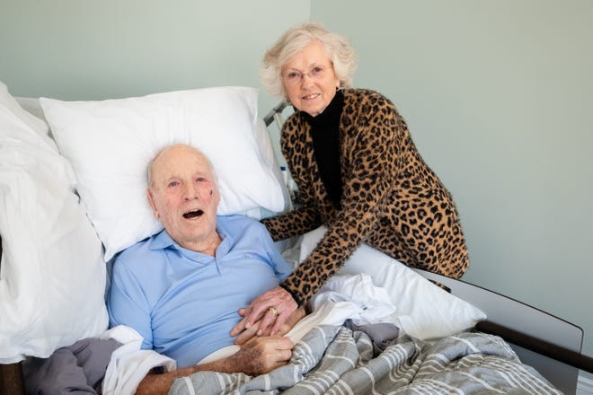 Sharon and Sherwood Palmateer pose for a portrait Thursday, Feb. 25, 2021, at Blue Water Hospice in Marysville. On his way to hospice, Tri-Hospital EMS drove Sherwood past several of his favorite landmarks, including his homestead and the St. Clair River.