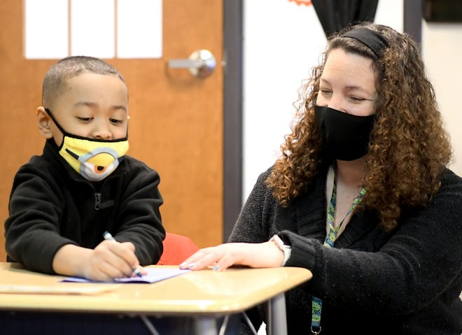 York Academy Regional Charter School kindergartener teacher Becky Frederick works with Yaviel Mendez whose class was making a thank you cards for healthcare workers Thursday, Feb. 25, 2021. The charter school's art honor society created the idea to make 3,000 cards for WellSpan York Hospital frontline healthcare workers. Bill Kalina photo