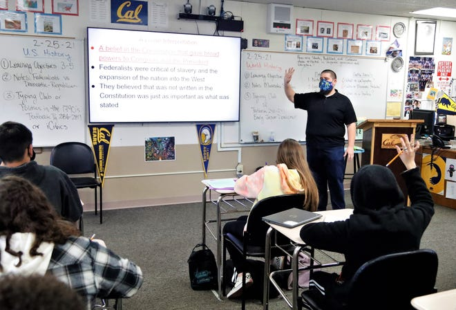 History teacher Nate Costa presents a lesson on the U.S. Constitution to his eighth-grade class at Shasta Lake School on Thursday, Feb. 25, 2021. Costa used the Jan. 6 Capitol insurrection as a way of teaching about other, past episodes of violence in Washington, D.C.