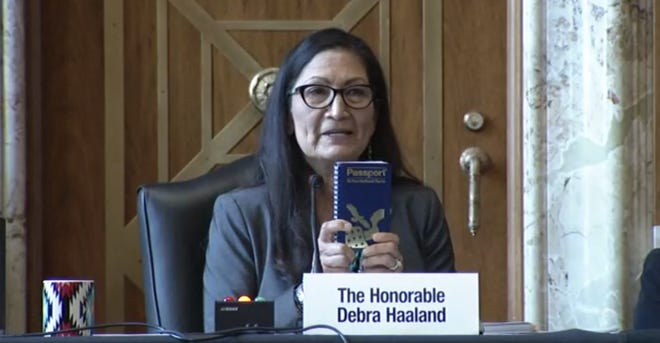 Rep. Deb Haaland (D-New Mexico) holds a National Parks Passport during her confirmation hearing to be the next Secretary of the Interior on February 23, 2021.