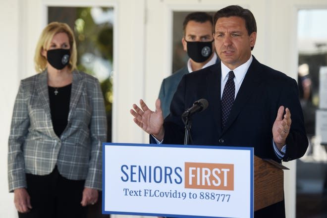 Florida Gov. Ron DeSantis holds a media briefing on Thursday at Spanish Lakes Fairways, part of the 55-plus Spanish Lakes Communities in St. Lucie County.