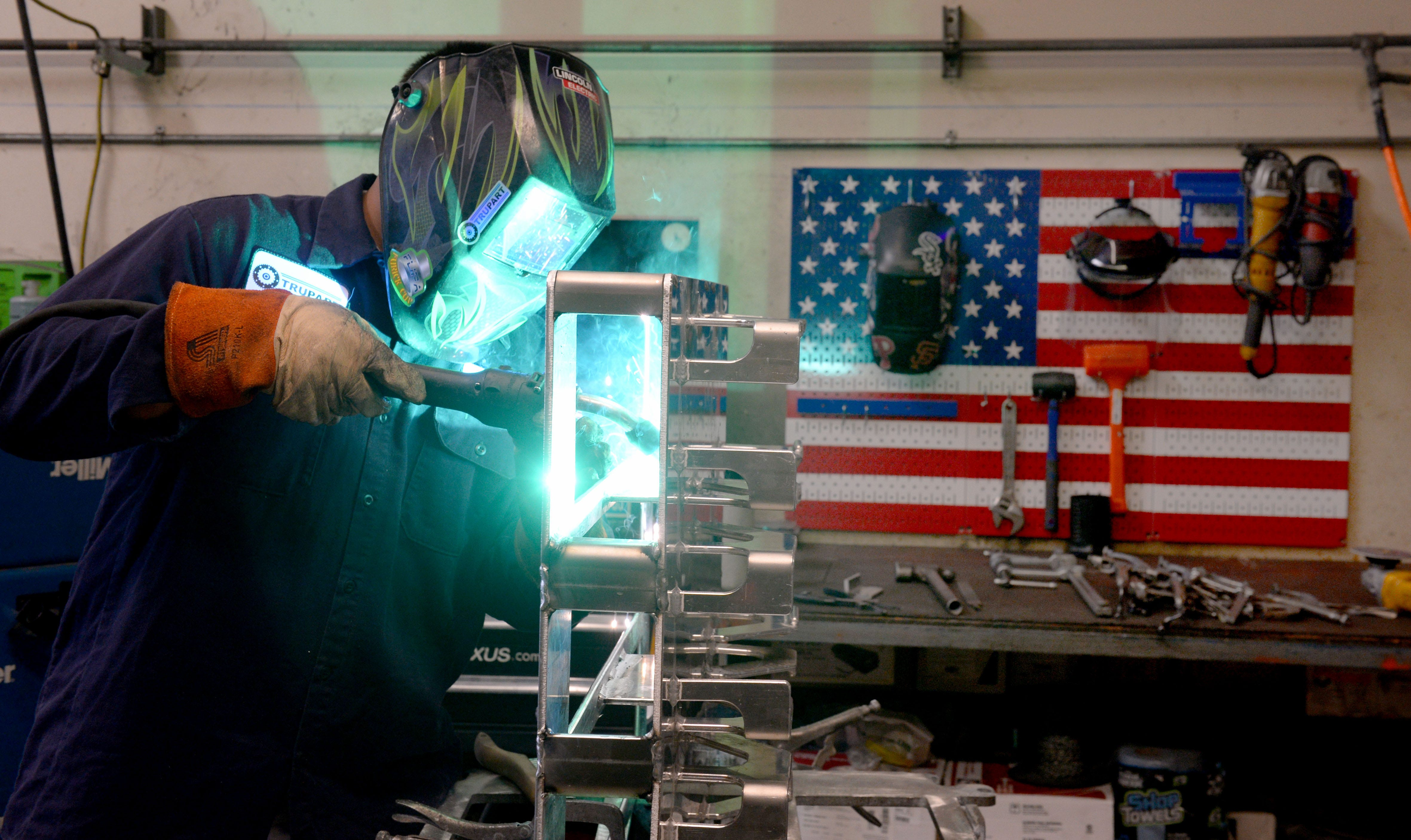 Robert Villanueva welds aluminum pallets at Trupart Manufacturing on Tuesday, Feb. 23, 2021. Trupart is a design, prototype, fabrication and production firm in Ventura that after nearly 50 years in business narrowly avoided closing its doors during the COVID-19 pandemic.