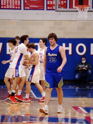 Senior Logan Smith walks off the floor as West Holmes celebrates a 55-39 win against visiting Maysville in a Division II sectional game on Wednesday in Millersburg. The Panthers ended 9-11 after an 0-6 start.
