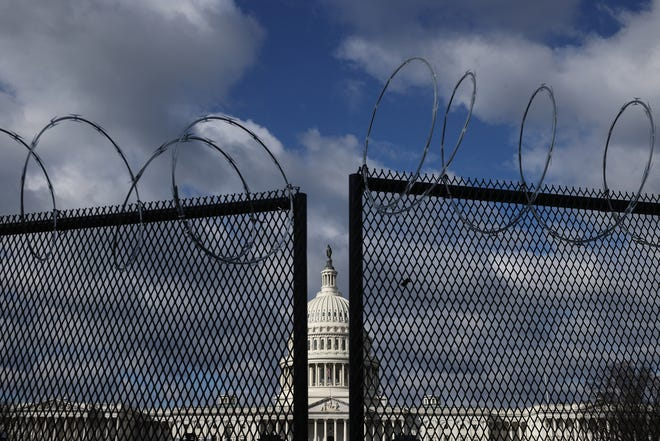 An eight-foot tall steel fence topped with concertina razor wire circles the U.S. Capitol January 29, 2021 in Washington, DC.