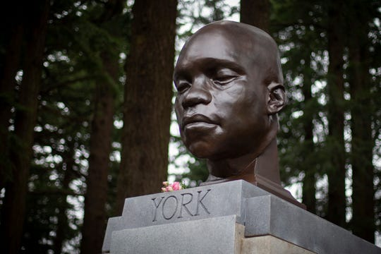A bust of York, a member of the Lewis and Clark expedition and the first African-American to cross the continent and reach the Pacific Coast, sits atop a pedestal at Mount Tabor Park in Portland, Oregon.