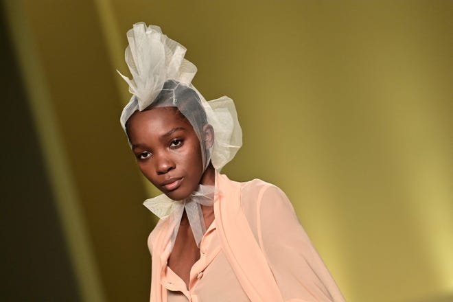 """A model presents a creation by Nigerian fashion stylist Joy Ijeoma Meribe from the collective """"Black Lives Matter in Italian Fashion"""" on February 17, 2021 in Milan during the filming of the fashion show that will open the Milan Fashion Week on February 24, 2021."""