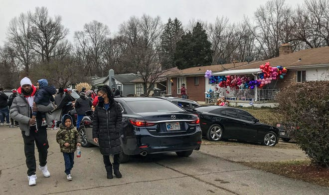 A vigil is held at the site of an Indianapolis mass shooting in January 2021 where Kezzie Childs, 42, Raymond Childs, 42, Elijah Childs, 18, Rita Childs, 13, Kiara Hawkins, 19, and her unborn baby boy were killed. Mass shootings have increased during the pandemic, Gun Violence Archive data shows. (Michelle Pemberton/IndyStar)