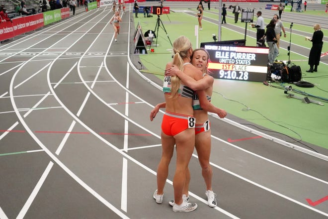 U.S. runners Emma Coburn, left, and Elle Purrier embrace after finishing first and second in the women's 2-mile race at the recent New Balance Indoor Grand Prix in New York. They will run in this weekend's most highly anticipated race (the women's 5K) at the Texas Qualifier in Austin.