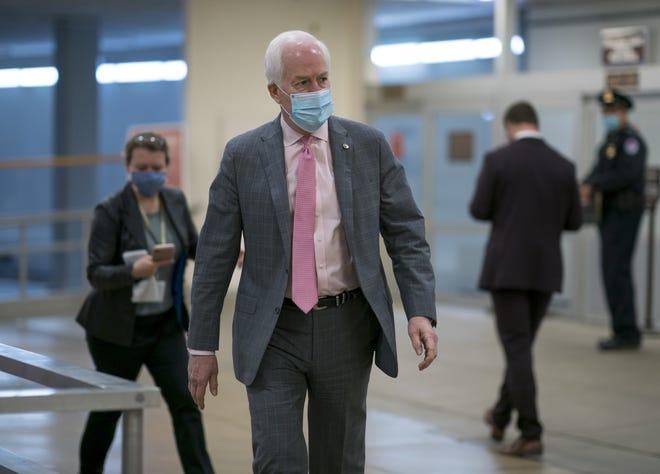 Sen. John Cornyn, R-Texas, arrives for votes on President Joe Biden's cabinet nominees, at the Capitol in Washington, Thursday, Feb. 25, 2021.