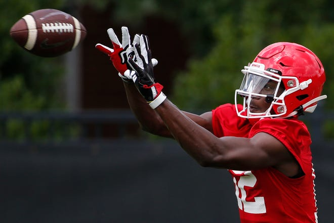 Georgia wide receiver Tommy Bush (12) looks to make a catch during an NCAA football preseason practice in Athens, Ga., Friday, August 2, 2019. The day was Georgia's first preseason practice. [Photo/Joshua L. Jones, Athens Banner-Herald]