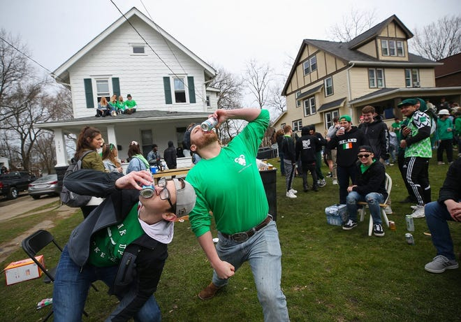 Despite the governor's suggestion of limiting crowd size, Kent State students party on the front lawn of their home on Summit Street in Kent during the Fake Paddy's Day celebration on March 14, 2020.