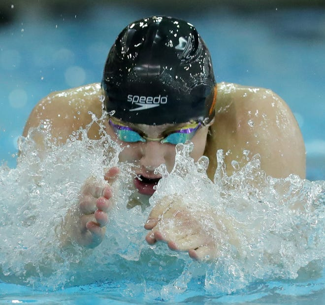 Ashland's Rylan McDaniel competes in the 100-yard breaststroke during the OHSAA Division II Swimming and Diving Championships at C.T. Branin Natatorium on Thursday in Canton.
