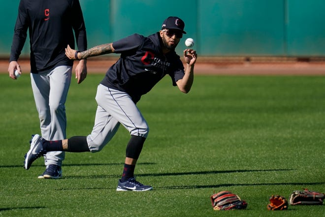 Cleveland outfielder Eddie Rosario shags fly balls in the outfielder during a spring training workout in Goodyear, Arizona. [Ross D. Franklin/Associated Press]