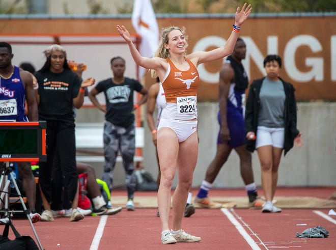 Texas long jumper Georgia Wahl tries to pump up the crowd during the Texas Relays in Austin on March 29, 2019.