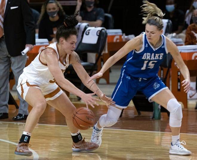 Texas' Audrey Warren beats Drake's Allie Wooldridge to a loose ball during their game in Austin in December. Warren produced her first double-double with the Longhorns this week.