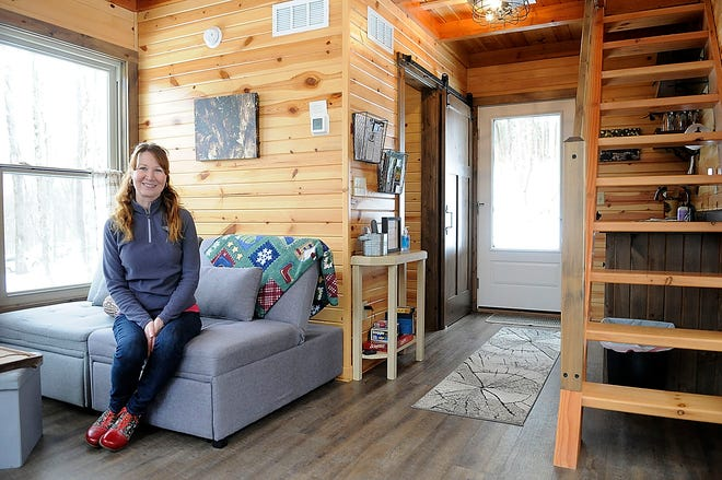 Christine Gardner poses inside of her Airbnb tiny cabin off of County Road 3006 a quarter mile from the Pleasant Hill Dam on Friday, Feb. 26, 2021. TOM E. PUSKAR/TIMES-GAZETTE.COM