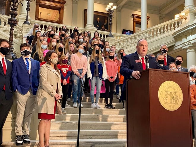 Dozens of student athletes in Georgia girls' sports joined state Rep. Phillip Singleton (center) on Feb. 4 to support his bill banning transgender participation.
