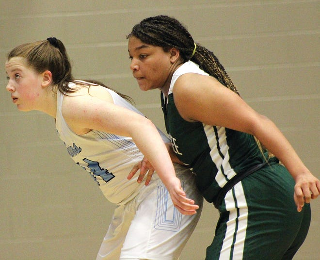 Freshman Kelsey Ward, left, garnered valuable varsity experience this season for the Bartlesville High School girls' basketball team.