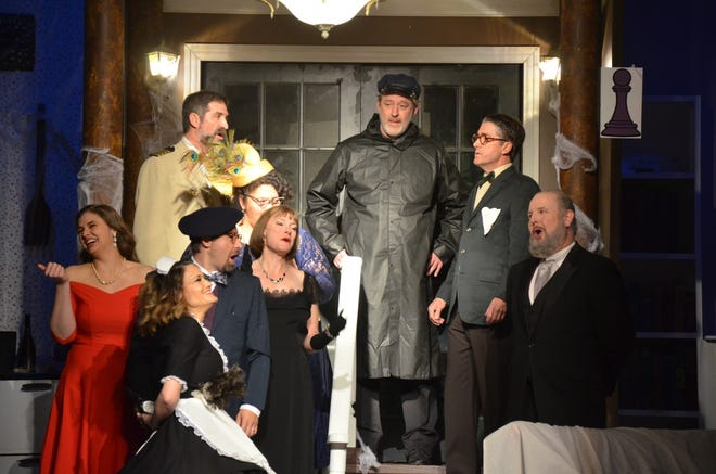 """It's all fun and games until the cop arrives, or so it seems, in a scene from Brownwood Lyric Theatre's production of """"Clue."""" A matinee performance of the comedy whodunnit will conclude an eight-show run at 2:30 p.m. Sunday. Pictured are, from left to right, foreground, Miss Scarlet (Cassia Rose), Yvette (Taffy Watts), Professor Plum (Levi Packer), Mrs. Peacock (Kandice Harris), and Mrs. White (Valerie Nelson). Pictured in the background, clockwise from left, are Colonel Mustard (Joe Dennis), the Cop (Drex Holt), Mr. Green (Paul Underwood), and Wadsworth (Jonathan Harvey). Tickets are available atwww.brownwoodlyrictheatre.com."""