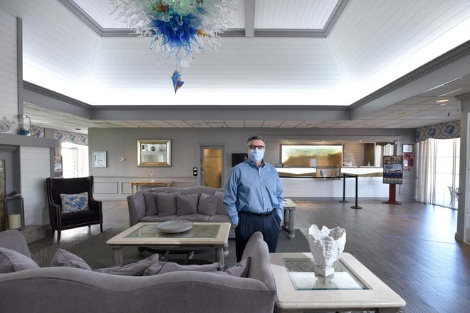 General manager Jon Bercume stands in the lobby of the Cape Codder Resort & Spa in Hyannis, which as of Monday can offer more seats and live music in its restaurants. Later this month, new state COVID-19 rules will also allow the guestlist for weddings there to increase significantly.