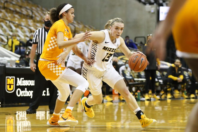 Missouri guard Haley Troup (13) dribbles the ball against Tennessee during a game Thursday night at Mizzou Arena.