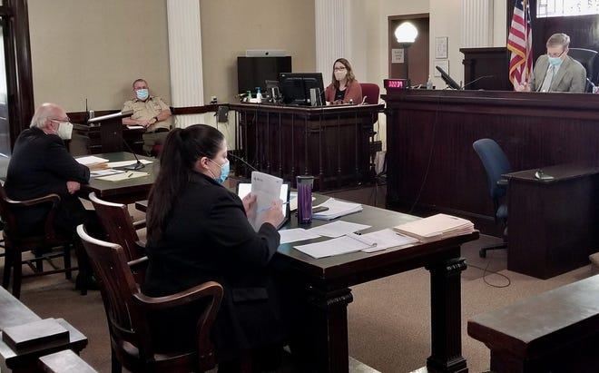 Associate Circuit Judge William Devoy, upper right, conducts a preliminary hearing Feb. 25, 2021, in an illegal gambling case in Linn County with Prosecuting Attorney Shiante McMahon, foreground, and defense attorney Nelson Mitten, left.