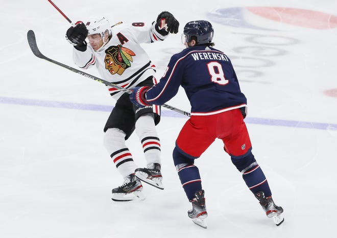 On a night defenseman Zach Werenski (8) returned to the lineup, the Blue Jackets held Patrick Kane (88) and the Blackhawks in check, at least until Kane's goal midway through the third period.