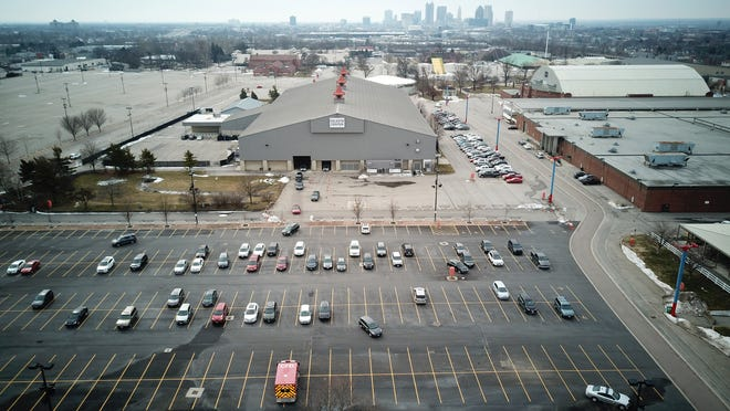A parking lot is partially filled with people who have been instructed to wait inside their cars for 15 minutes after receiving a COVID-19 vaccine at the drive-through Celeste Center at the Ohio Expo Center, 717 E. 17th Ave. in Columbus on Friday, Feb. 26,