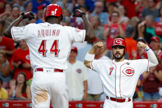 Aristides Aquino celebrates with Reds teammate Eugenio Suarez after Aquino hit a two-run home run against the Chicago Cubs on Aug. 8, 2019. Both players followed strong 2019 seasons with struggles in 2020.