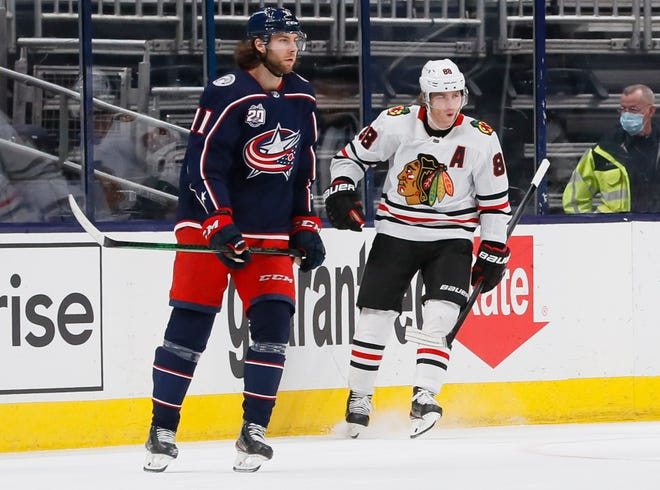 Chicago Blackhawks right wing Patrick Kane (88) celebrates scoring a goal behind Columbus Blue Jackets center Kevin Stenlund (11) during the third period of the NHL hockey game at Nationwide Arena in Columbus on Thursday, Feb. 25, 2021. The Blue Jackets lost 2-0.