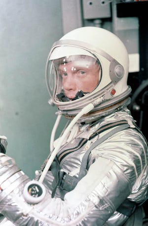 Astronaut John H. Glenn Jr. dons his silver Mercury pressure suit in preparation for launch. On Feb. 20, 1962 Glenn lifted off into space aboard his Mercury Atlas (MA-6) rocket and became the first American to orbit the Earth.
