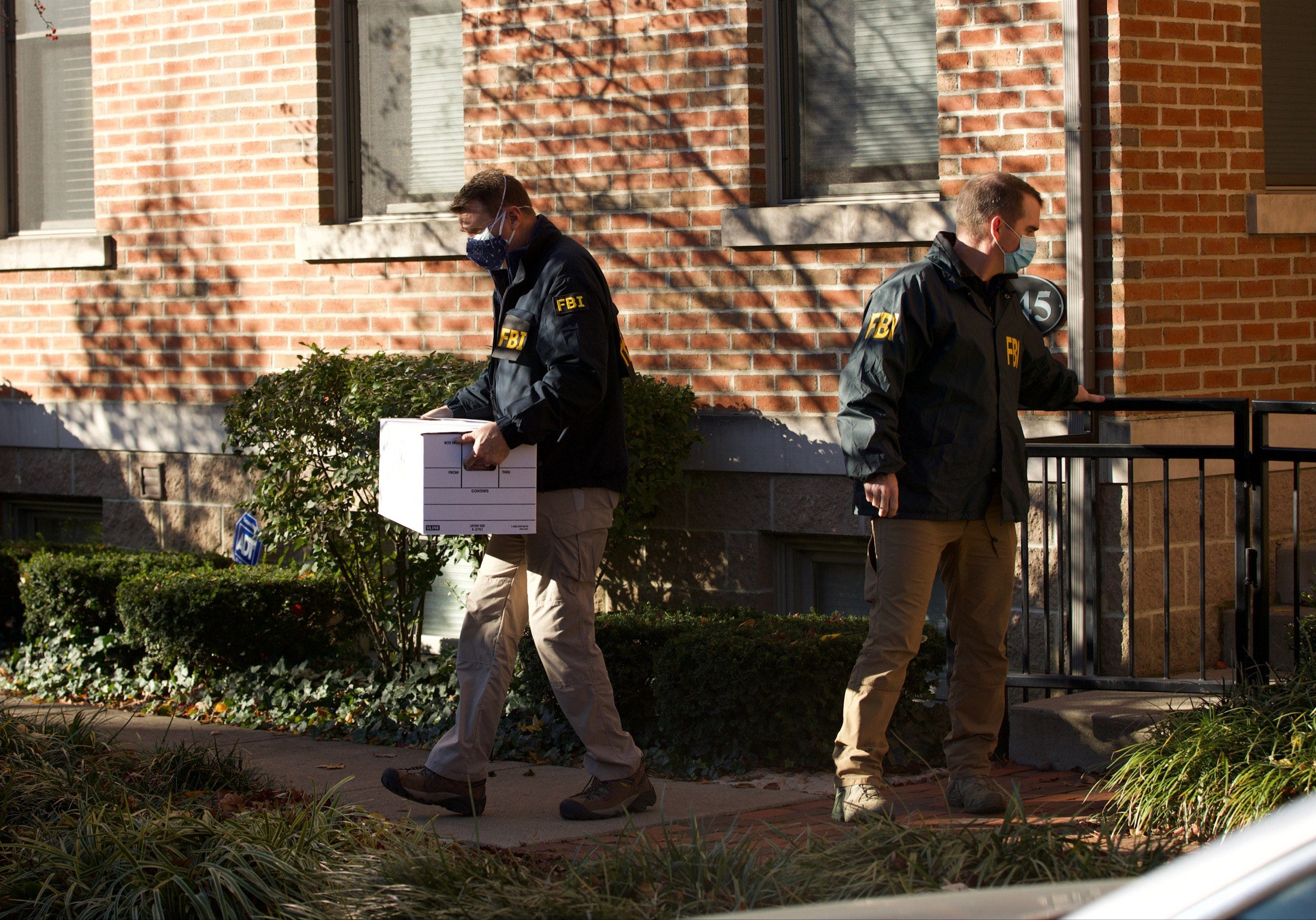 FBI agents remove items from the German Village home of Public Utilities Commission of Ohio Chairman Sam Randazzo in Columbus on Nov. 16, 2020.