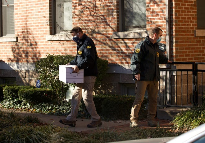 FBI agents remove items from the German Village home of Public Utilities Commission of Ohio Chairman Sam Randazzo in Columbus on Nov. 16, 2020. Federal investigators sent two subpoenas to the commission, seeking records related to Randazzo, House Bill 6 and other matters.