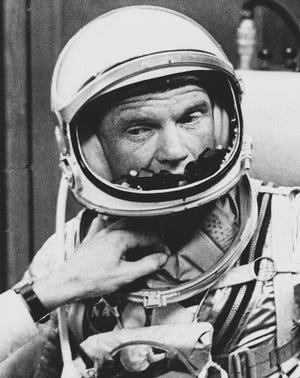 A technician adjusts the neck wrap of astronaut John Glenn in this Feb. 20, 1962 photo.