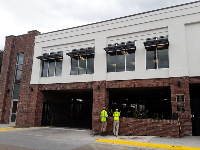 Construction workers put some finishing touches on the addition to the Lafourche Parish Library's Thibodaux branch on Thursday.