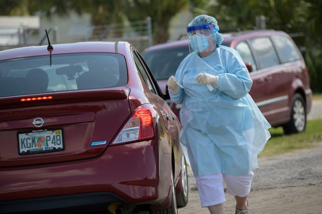 Health care workers conduct testing COVID-19 at the Lake County Fairgrounds. [Cindy Peterson/Correspondent]