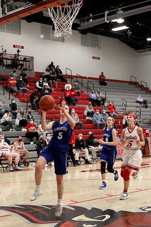 Cambridge sophomore Braxton King (5) drives in for a layup during Thursday's Division III district semi-final game with host Sandy Valley. King tallied a game-high 18 points to lead the Lady Bobcats to a 51-41 victory for a spot in the district championship game on Saturday at Hiland.