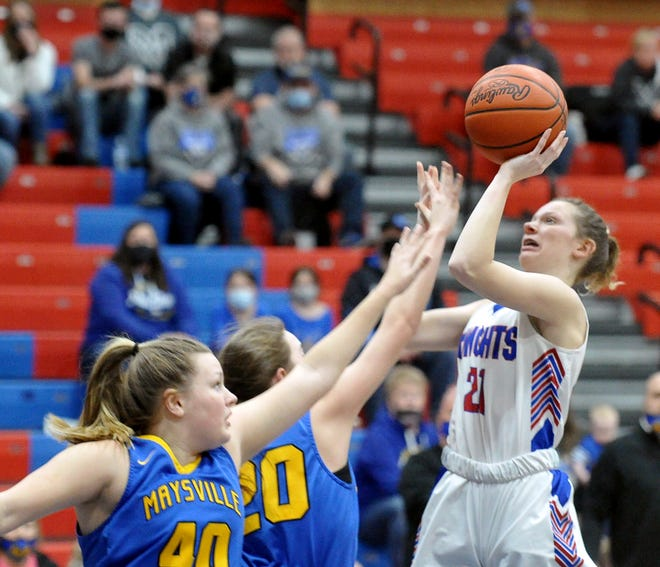 West Holmes' Melanie Fair puts up a shot in the lane over Maysville's Trinity Taggart and Emily Lawson. Fair scored 12 points in the win.