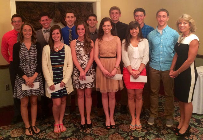 Darla Stitzlein (shown right) with Hiland High School scholarship recipients.