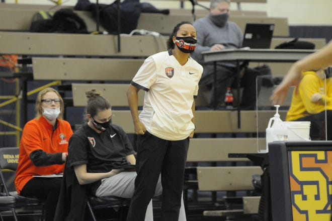 Morenci graduate and Indiana Tech assistant coach Kylene (Spiegel) Biggs looks onto the court during Tuesday's game against Siena Heights.