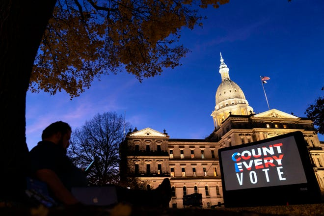 """The phrase """"Count Every Vote"""" is displayed on a large screen organized by an advocacy group Nov. 6 in front of the Michigan state Capitol in Lansing while election results in several states had yet to be finalized."""