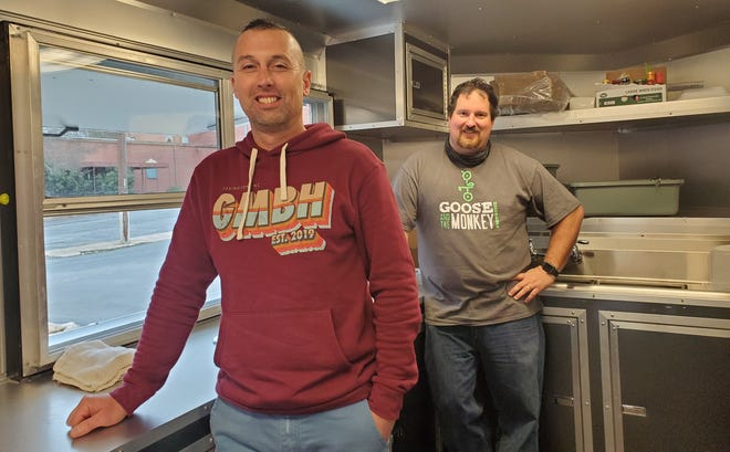 Brent Moore (front), owner of Goose and the Monkey Brew House, and Tyler Prevatte (back), owner of Perfect Blend Coffee House, have partnered to open Pour Folk Pizza food trailer. The mobile pizza restaurant is parked beside the brew house and will offer artisan flatbread pizzas during lunch hours Monday through Friday.