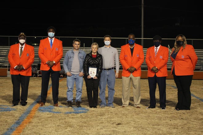 """Lexington Senior High School's 2020 Hall of Fame class was honored Thursday night at Philpott Memorial Stadium. Pictured from left are John """"Bam Bam""""' Medley, Cory Holt, family of the late Randy Swicegood ( wife  - Amy Joe and two sons), Dennis """"Bird"""" Scott, Robert Craven and Monique Murphy. [Contributed photo]"""