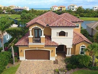This house on Cypresswood Drive South, in a gated community, has four bedrooms and three baths in 3,319 square feet of living space. Built in 2018 on a golf course, it also has two balconies, an oversized garage, a fireplace and a screened lanai. It sold recently for $715,000.
