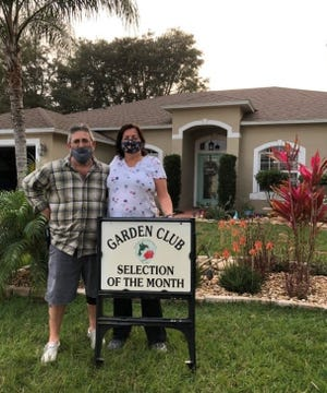 Vinnie and Angela Yacuzzi in front of their Feling Lane home.