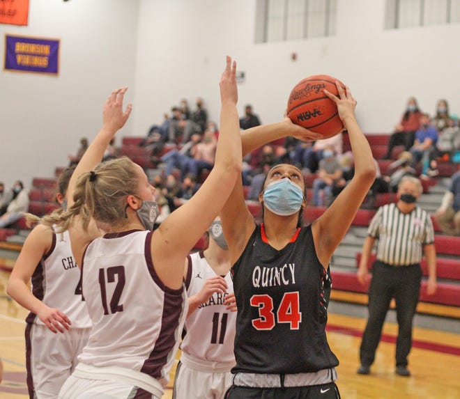 Quincy's Neha Jain (34) goes up strong for two while Union City's Megann Russell defends Thursday night in the Orioles win over the Chargers.