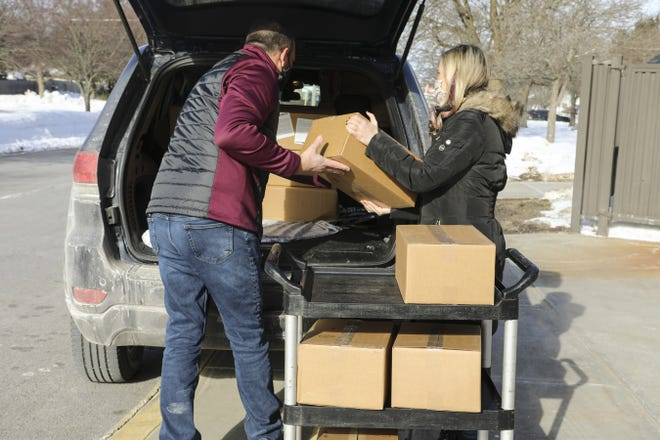Superintendent Joseph Palmer, Business Administrator Kacey Sheppard-Thibault and Family School Navigator Carlee Doxtader delivered meal kits and bags of nonperishable foods to students and their families prior to the recent winter recess.