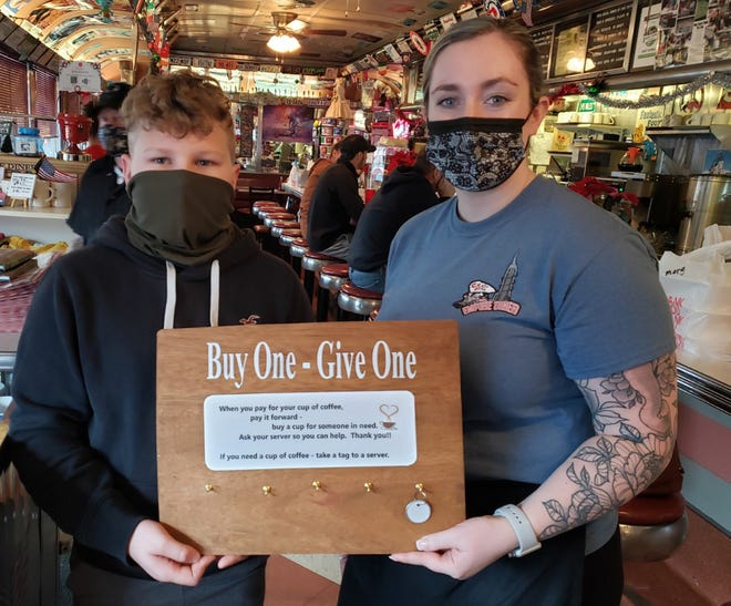 Dylan Longwell, of Little Falls, left, is shown here with Abbie Frappier, a manager at Crazy Otto's Empire Diner in Herkimer.  Customers can pay it forward to provide a hot beverage or sandwich to someone in need through a program Dylan initiated.