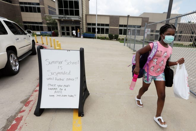 Nivea Ross, 8, a summer school student at North Hill Elementary School, makes her way to a waiting vehicle at the end of the school day July 7 at the Burlington elementary school. The Burlington School District plans to expand its summer school offerings at all grade levels to help students catch up on what they missed out on due to the pandemic and school closures.